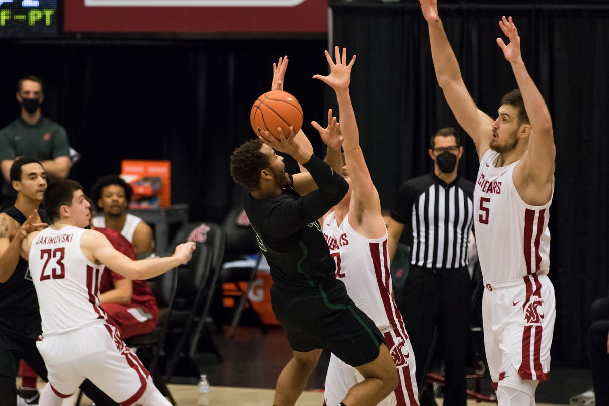 PULLMAN, WA - DECEMBER 13: Washington State guard Ryan Rapp (22) and center Volodymyr Markovetskyy (15) attempt to block a shot during the first half of a non-conference matchup between the Portland State Vikings and the Washington State Cougars on December 13, 2020, at Beasley Coliseum in Pullman, WA.