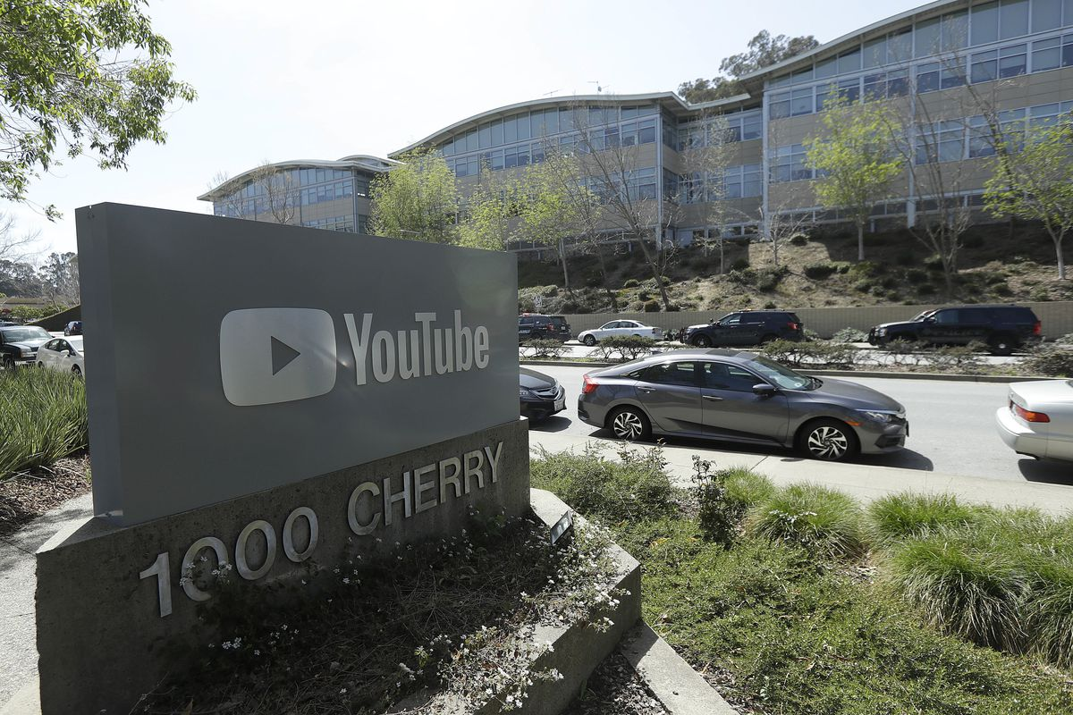 In this Tuesday, April 3, 2018, file, a YouTube sign is shown across the street from the company's offices in San Bruno, Calif.