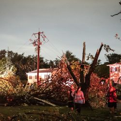 Tornado damage at Evergreen Ln. and Janes Ave. in Woodridge early Monday morning.
