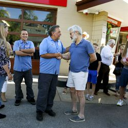Bobby Rose, owner of 3rd Ave. Car Clinic, center left, speaks with Jon Hale at his retirement party in Salt Lake City on Thursday, May 27, 2021. Rose is retiring and closing his auto repair shop after 34-plus years.