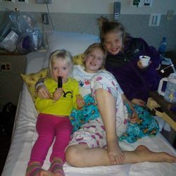 Sisters Pyper, Sarah and Heather Magera on Sarah's bed. When one child is sick -- Sarah has AML leukemia -- all the children in a family are impacted.