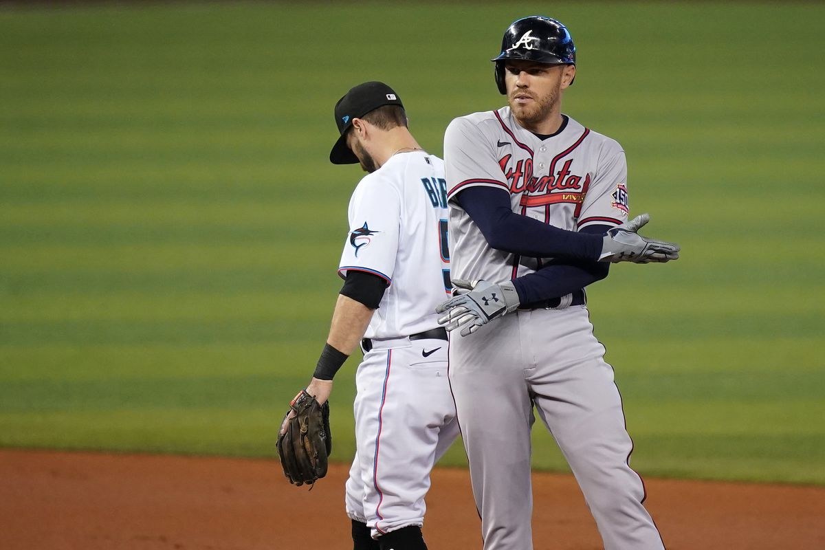 Atlanta Braves first baseman Freddie Freeman (5) gestures to the dugout after doubling in the 1st inning against the Miami Marlins at loanDepot park.