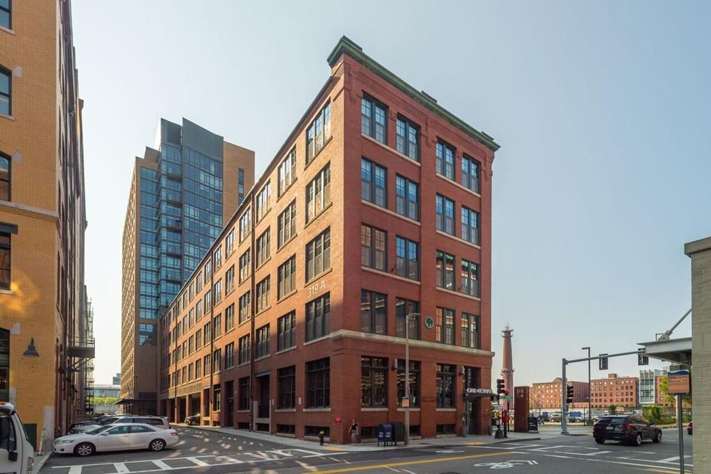 A narrow five-story, rectangular building on a city block.