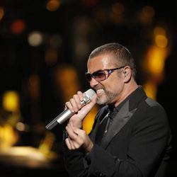 British singer George Michael performs at a concert to raise money for AIDS charity Sidaction, during the Symphonica tour at Palais Garnier Opera house in Paris, France, Sunday, Sept. 9, 2012.