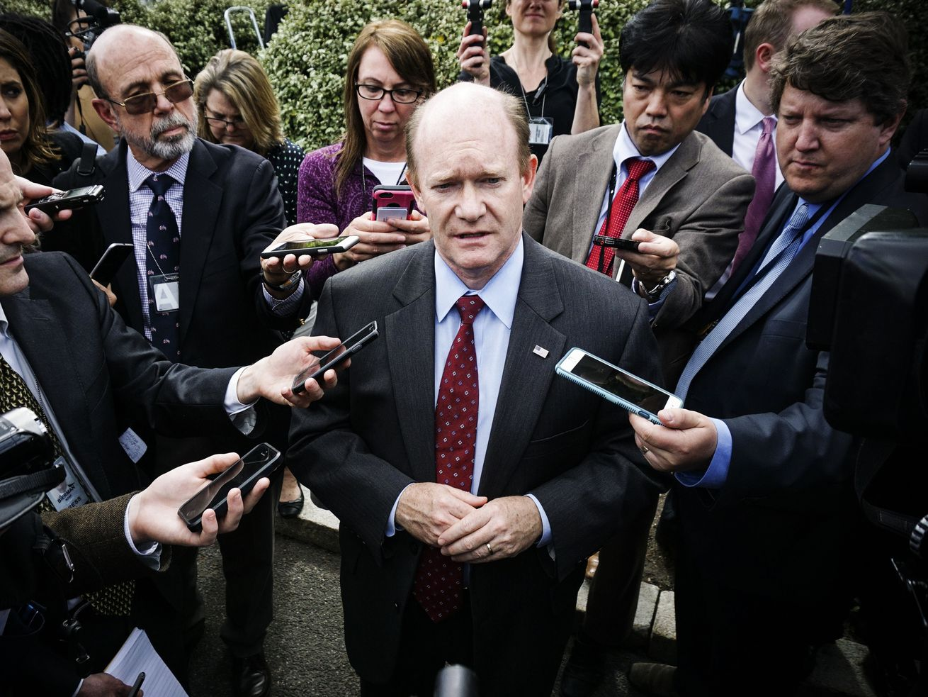 Sen. Chris Coons (D-DE) speaks to reporters after a briefing in April last year for US senators on North Korea.