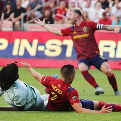 Real Salt Lake forward Bobby Wood (7) gets tangled up with Colorado Rapids defender Lalas Abubakar (6) at Rio Tinto Stadium in Sandy on Saturday, July 24, 2021.