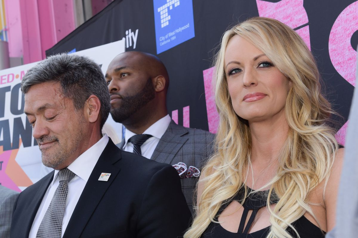 Stormy Daniels and former West Hollywood Mayor John J. Duran onstage at an event in 2018.