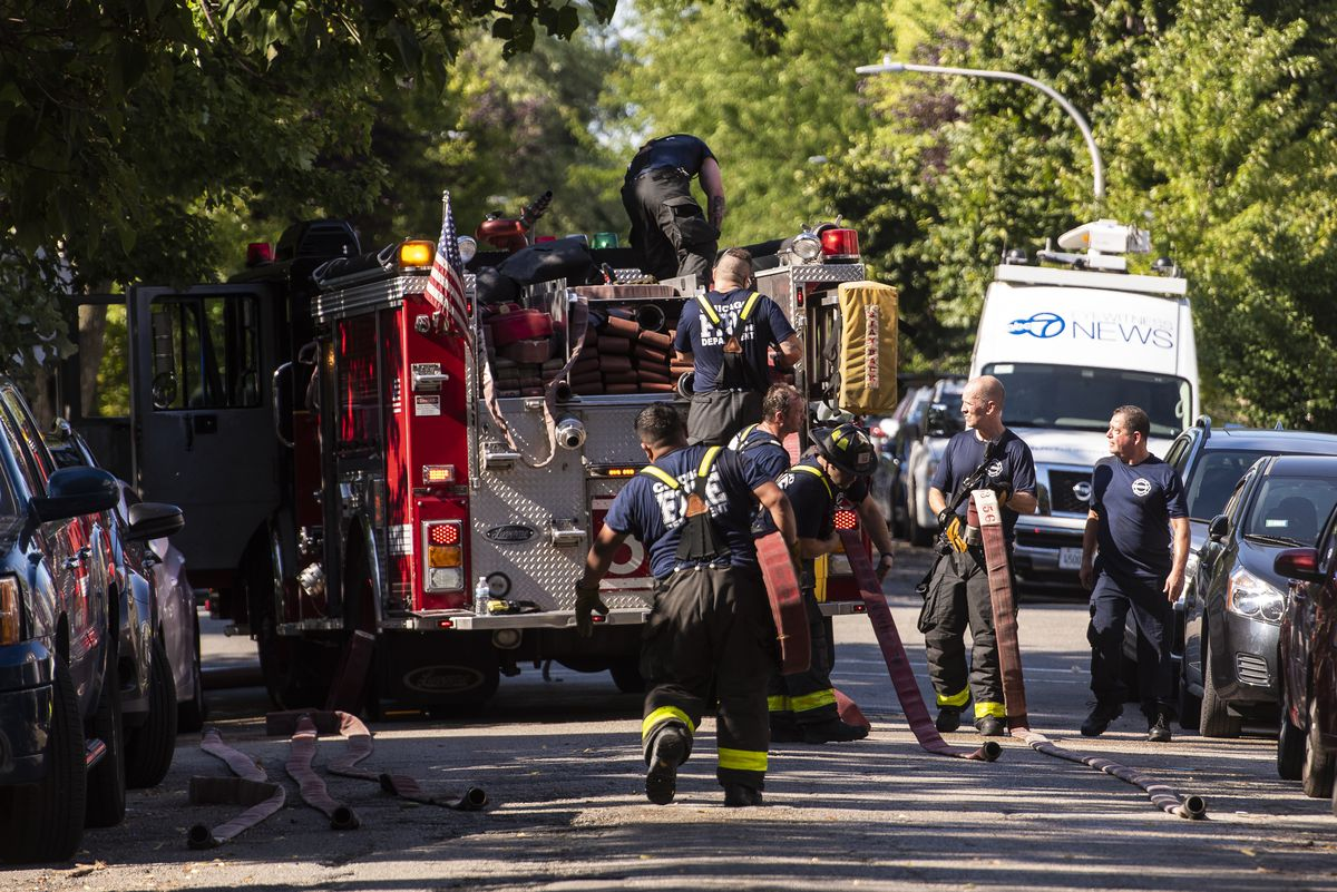 Chicago firefighters respond to a 2-11 alarm blaze at a home in the 3300 block of North Albany in the Avondale neighborhood, Thursday, Aug. 20, 2020. | Tyler LaRiviere/Sun-Times