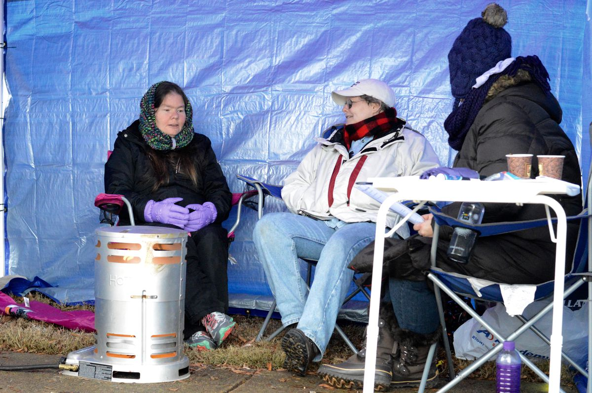 """Sandra Yarbrough (left) speaks with other parents holding spots at this year's """"tent city."""""""