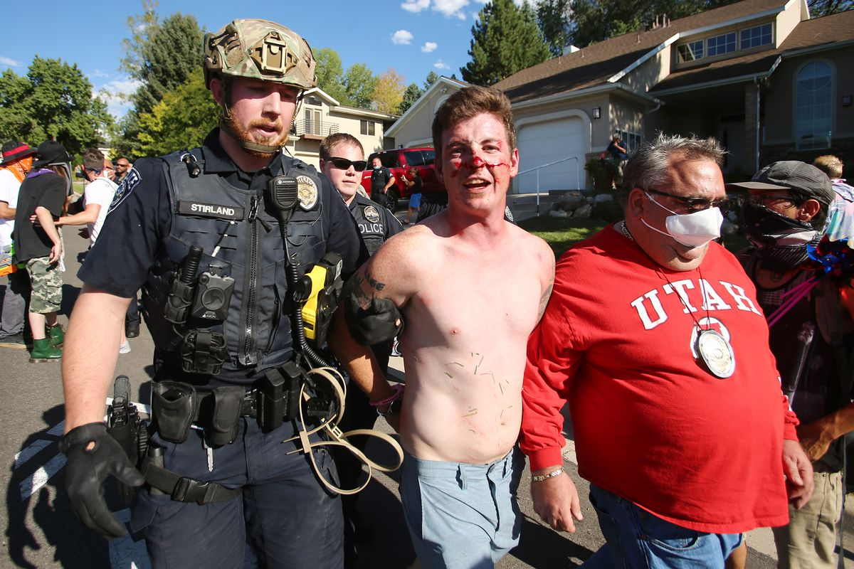 Gabriel Pecoraro is taken into custody after police and marchers collided in the streets of Cottonwood Heights on Sunday, Aug. 2, 2020. The group was marching on 6710 South when police blocked them at Cristobal Street and a confrontation ensued. Police said eight or nine protesters were arrested.