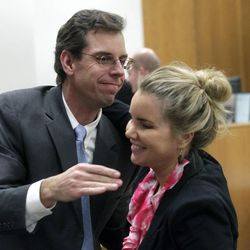 Randall Spencer congratulates fellow defense attorney Susanne Gustin at the conclusion of Martin MacNeill's murder trial in Provo's 4th District Court on Friday, Nov. 8, 2013.