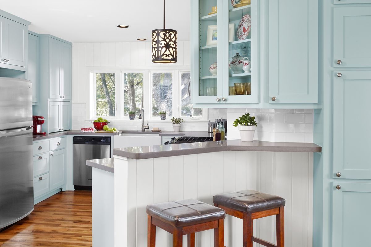 Kitchen with repainted cabinets.