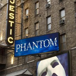 """FILE - In this Jan. 19, 2012 file photo, the Majestic Theatre and the marquee for """"The Phantom of the Opera"""" are seen in New York. Box office revenues show that """"The Lion King"""" has recently swiped the title of Broadway's all-time highest grossing show from """"The Phantom of the Opera."""""""