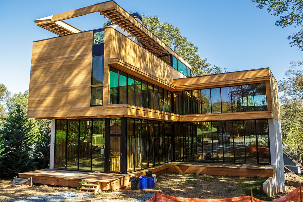A sizable new-build modern with rooftop patio on Olympic Place in Decatur.