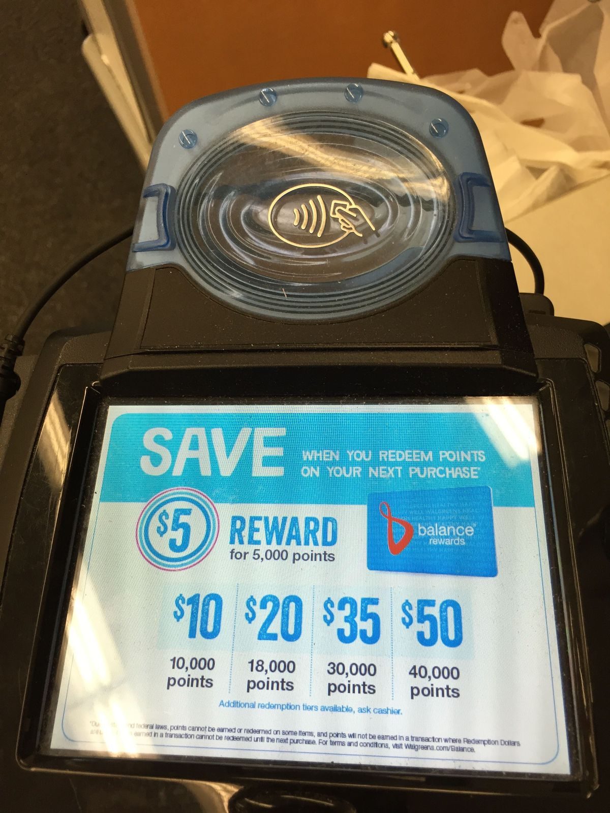 A wireless payment terminal at Walgreen's, compatible with Apple Pay