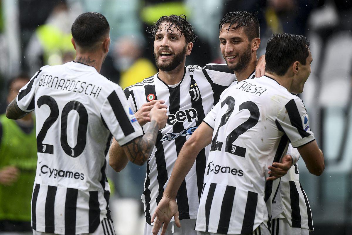 Manuel Locatelli (C) of Juventus FC celebrates with his...
