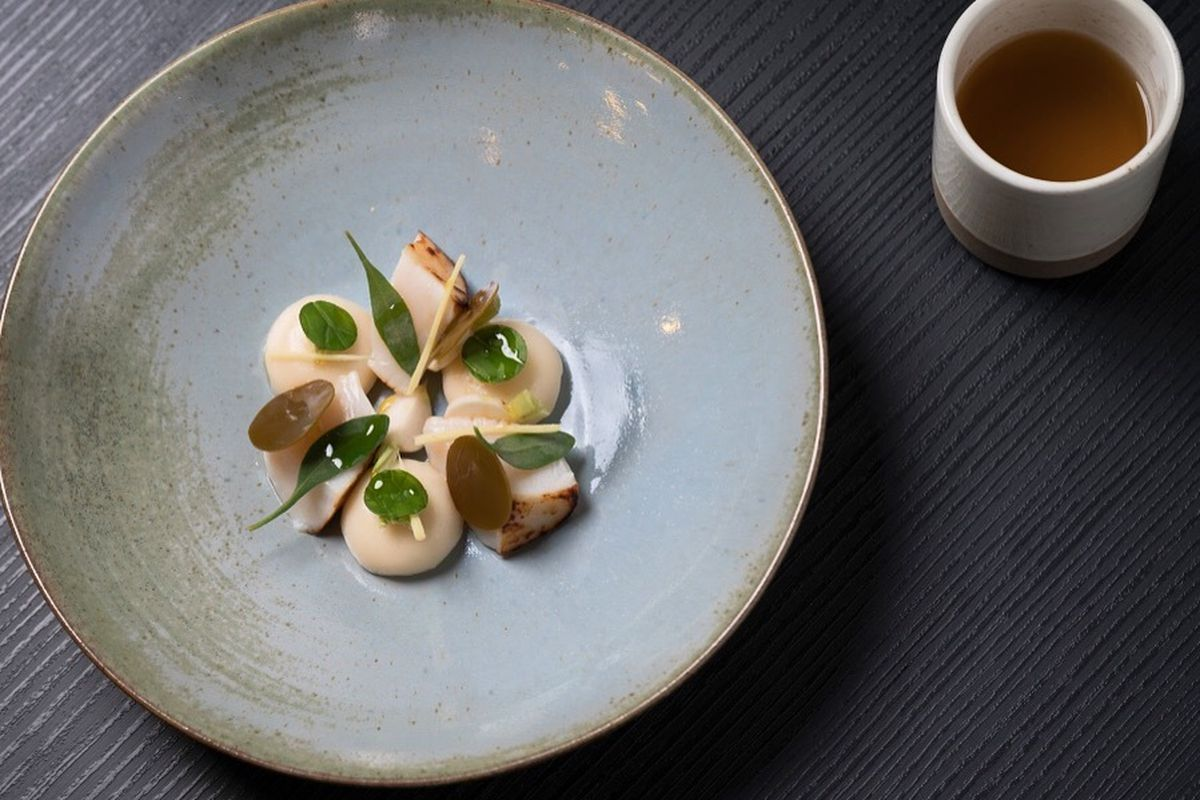 'Lost Souls in a Fish Bowl':Orkney scallops cooked two different ways: roasted, and used to make a scallop ravioli filled with scallop mousse. Topped with English wasabi, discs of kelp and blowtorched baby turnip, the dish is finished with a dashi b