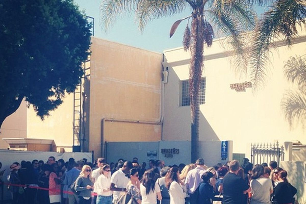 """Shoppers wait in line for the Hermès sample sale in LA. Photo via <a href=""""http://la.racked.com/archives/2013/08/23/the_herms_beverly_hills_sale_is_a_glorious_madhouse.php"""">Racked LA</a>."""