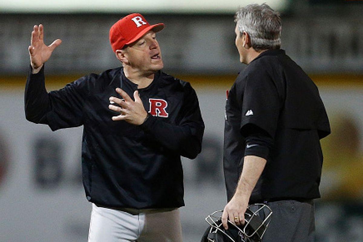 Rutgers baseball coach Joe Litterio argues with an umpire in a game against Miami (FL)