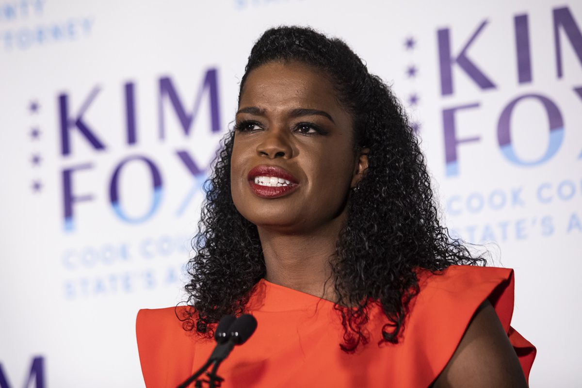 Flanked by family members, incumbent Cook County State's Attorney Kim Foxx speaks to reporters at the Hotel Essex Chicago after winning in the Democratic primary, Tuesday night, March 17, 2020.
