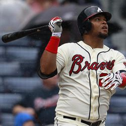 Atlanta Braves' Juan Francisco follows through with a two-run home run in the second inning of a Major League Baseball game against the New York Mets in Atlanta, Wednesday, April 18, 2012.