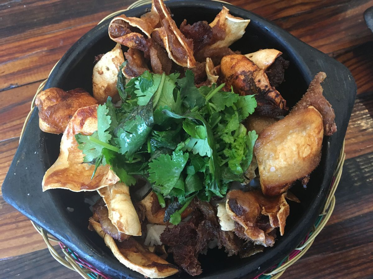 fried pig ears on coconut rice with mixed herbs at The Royal [Photo: Laura Hayes]