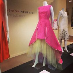 """Takado Yamanaka's dress is inspired by the Boat Orchid. """"The vibrant shades of pink, subtle yellows, and distinctly shaped petals of the [flower] provided my inspiration,"""" she said. The dress has a hidden, sheer underskirt."""