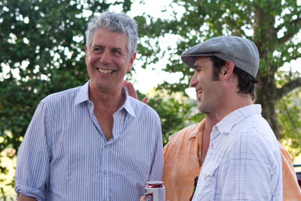 Anthony Bourdain and sculptor Toby Rodriguez at a boucherie in Eunice, LA.