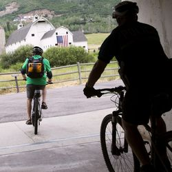 """Summit County and Park City council members ride electric bikes to a press conference launching the nation""""™s first fully electric bike-share program in Park City on Wednesday, July 19, 2017."""
