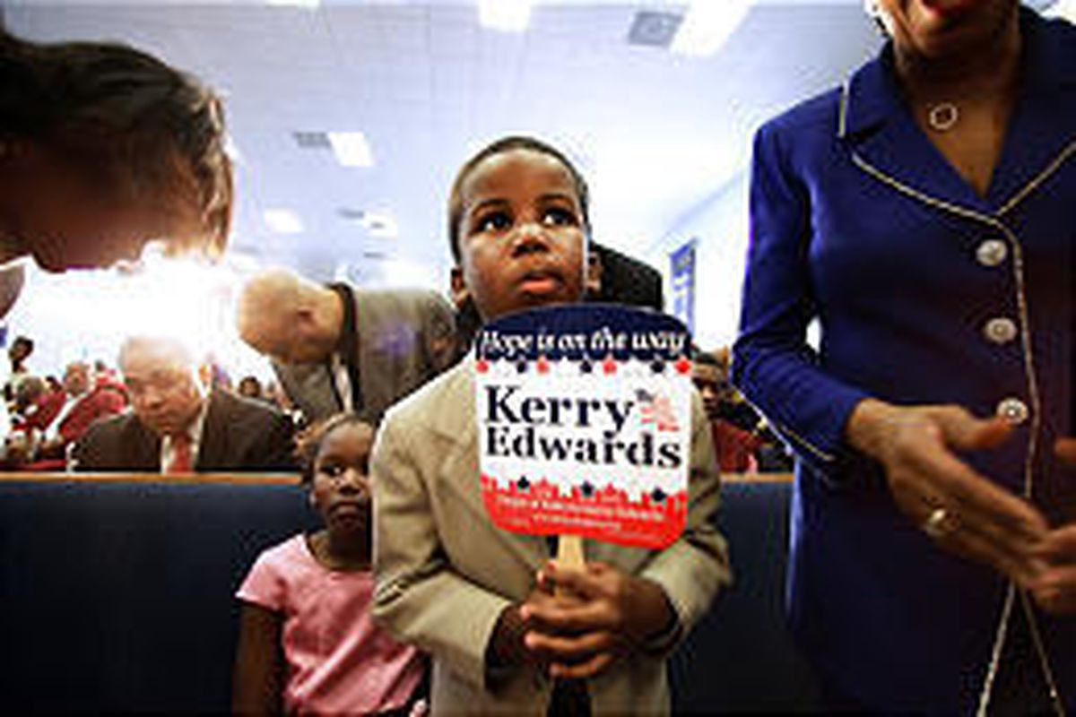 Kendrick Meek and sister Lauren, left, children of Rep. Kendrick Meek, D-Fla., watch for John Kerry at Miami church.