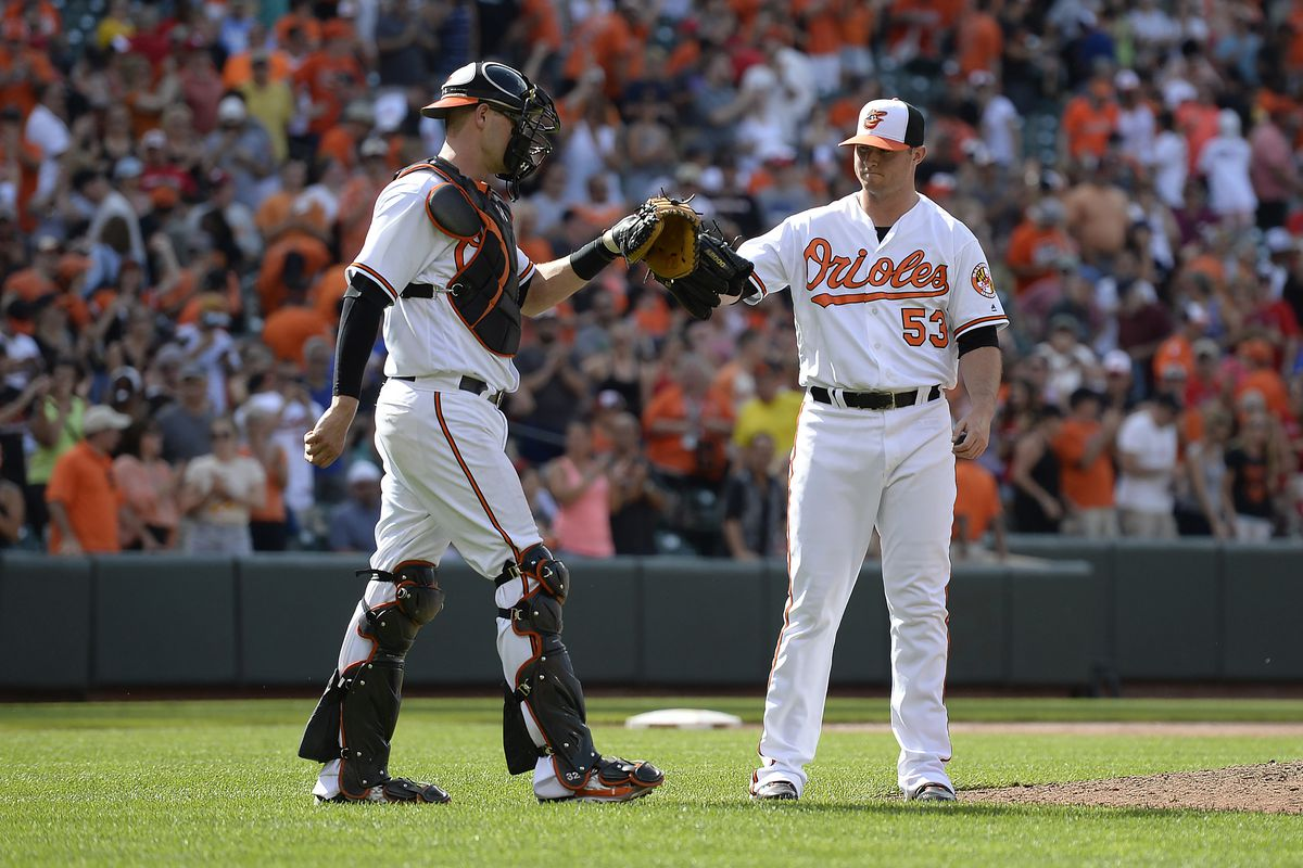 Zach Britton celebrates after saving a game for the Orioles.