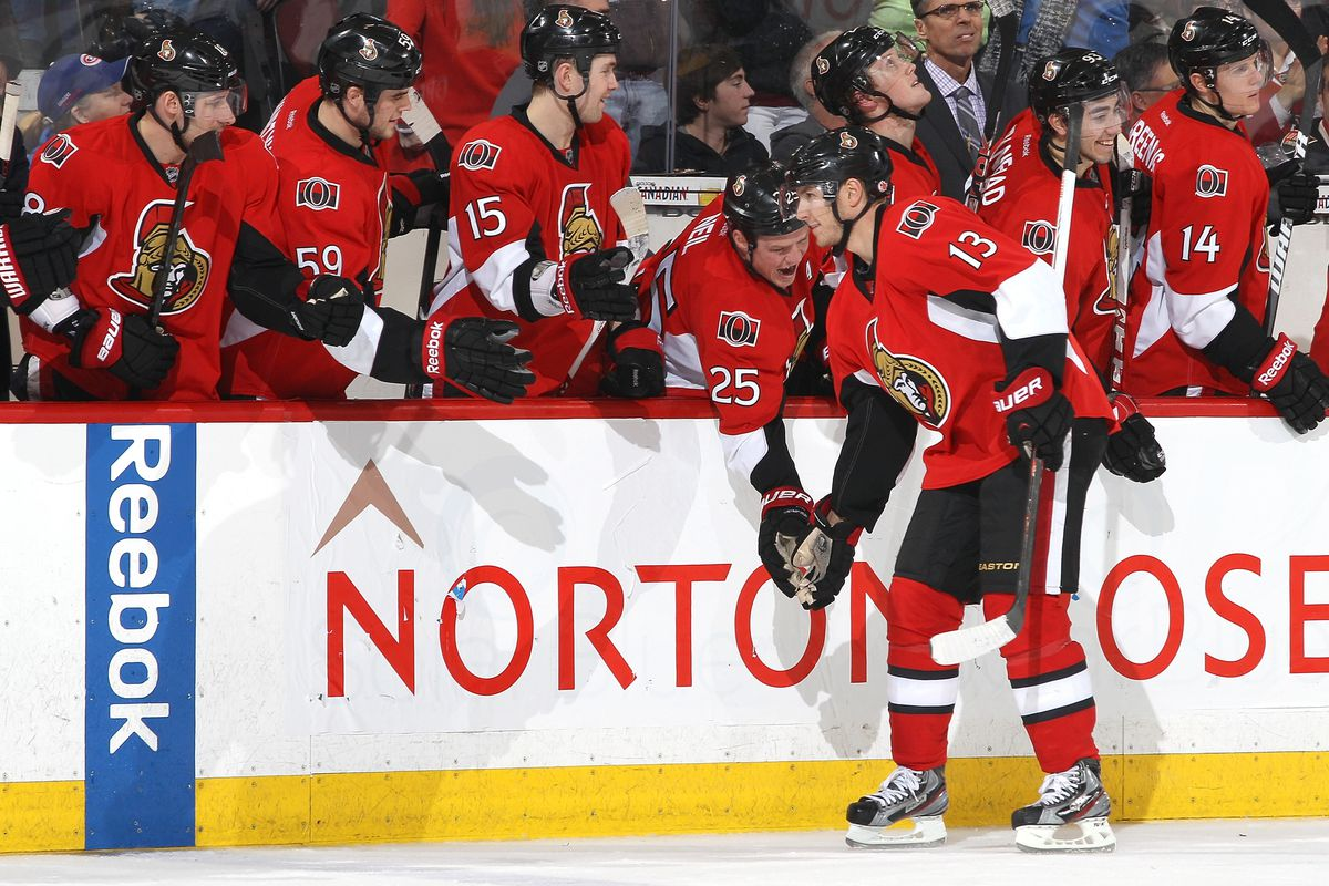 Chris Neil realigns the high-five procession, much to Peter Regin's dismay