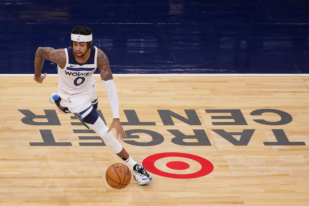 Minnesota Timberwolves guard D'Angelo Russell dribbles in the third quarter against the Memphis Grizzlies at Target Center.