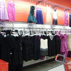 The wall of 50% Go International Collection re-issued dresses