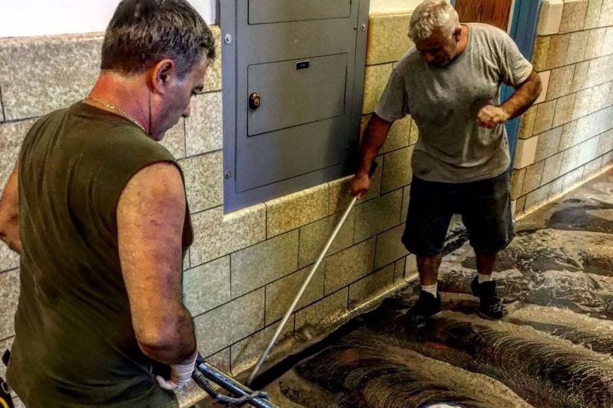 "At P.S. 86 in the Bronx, Martin Cotaj, handyman, and Gjon Kocaj, a ""fireman"" who manages the school's furnace, buff a floor"