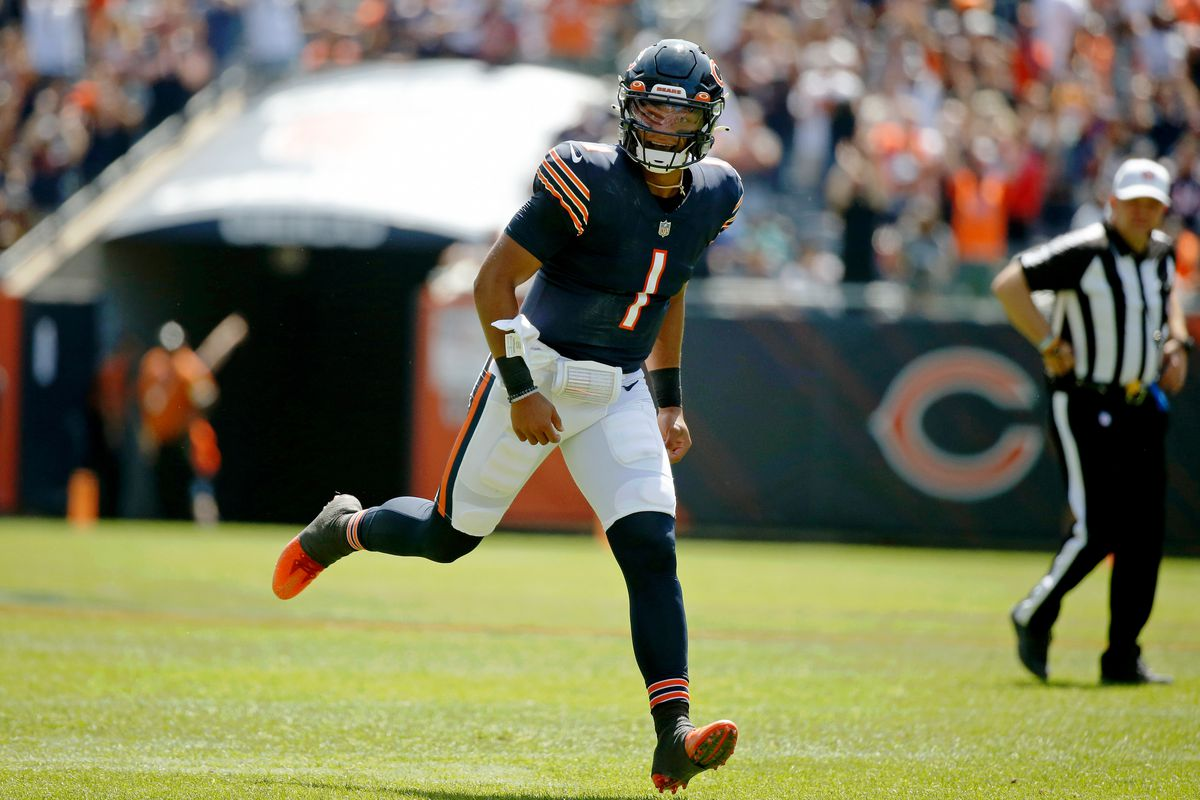 Chicago Bears quarterback Justin Fields (1) celebrates his touchdown pass against the Miami Dolphins to tight end Jesse James (not pictured) during the second half at Soldier Field.