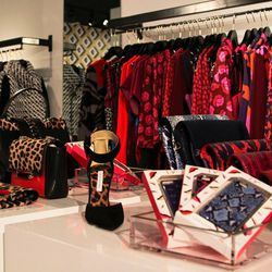 The complete range of DVF accessories is scattered on the tables, as this is the first store to carry <em>everything</em>, including handbags, shoes, scarves, leather goods and sunglasses.