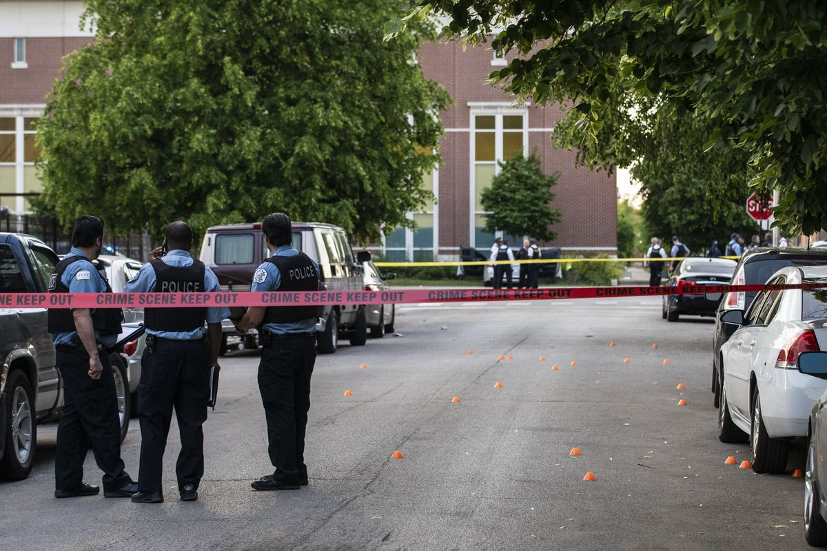 Chicago police investigate in the 700 block of North Spaulding Avenue, where a 40-year-old man was shot multiple times while he was riding in a car on the West Side on Memorial Day.