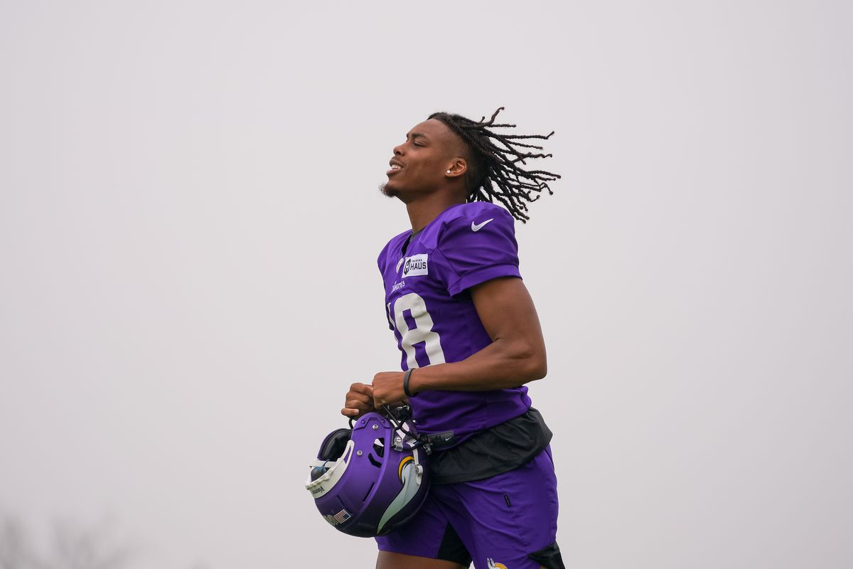 Minnesota Vikings wide receiver Justin Jefferson (18) takes the field at training camp at TCO Performance Center.