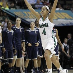 Notre Dame guard Skylar Diggins (4) celebrates victory after the NCAA women's Final Four semifinal college basketball game against Connecticut in Denver, Sunday, April 1, 2012. Notre Dame won 83-75.