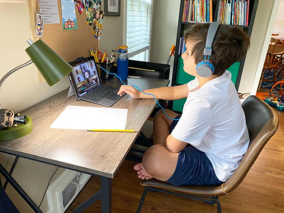Cooper Tate attends class over Zoom last spring while learning virtually from his Memphis home.