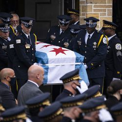 Pallbearers carry the casket to the hearse for Chicago Police Officer Ella French after her funeral at St. Rita of Cascia Shrine Chapel, Thursday, Aug. 19, 2021. French was fatally shot and her partner was critically wounded while in the line of duty on Aug. 7 in West Englewood.