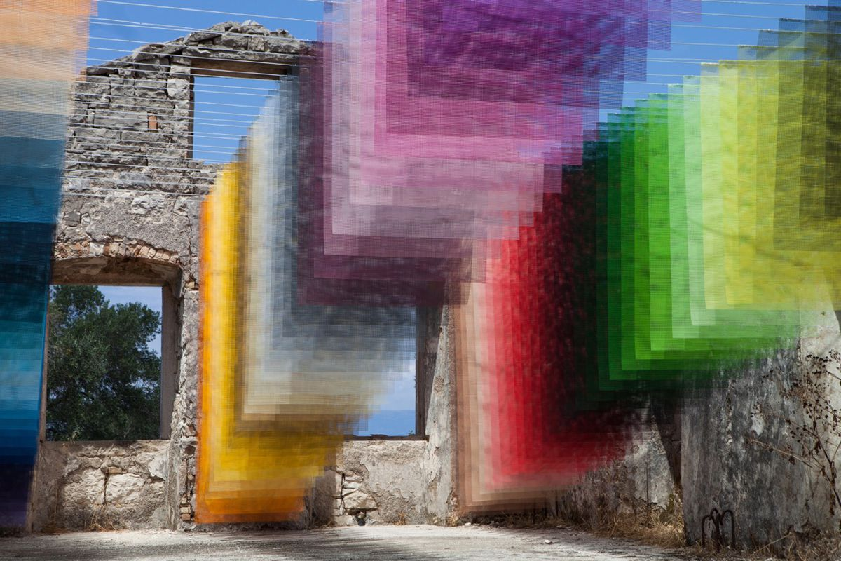 Layers of colorful fabric in old courtyard