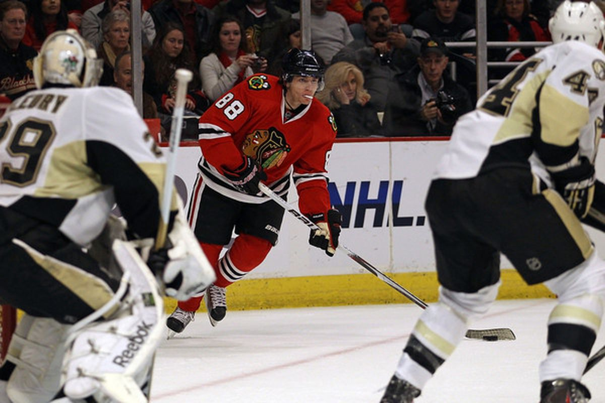 Patrick Kane of the Chicago Blackhawks looks to pass between Marc-Andre Fleury and Brroks Orpik of the Pittsburgh Penguins at the United Center on February 20 2011 in Chicago Illinois. (Photo by Jonathan Daniel/Getty Images)