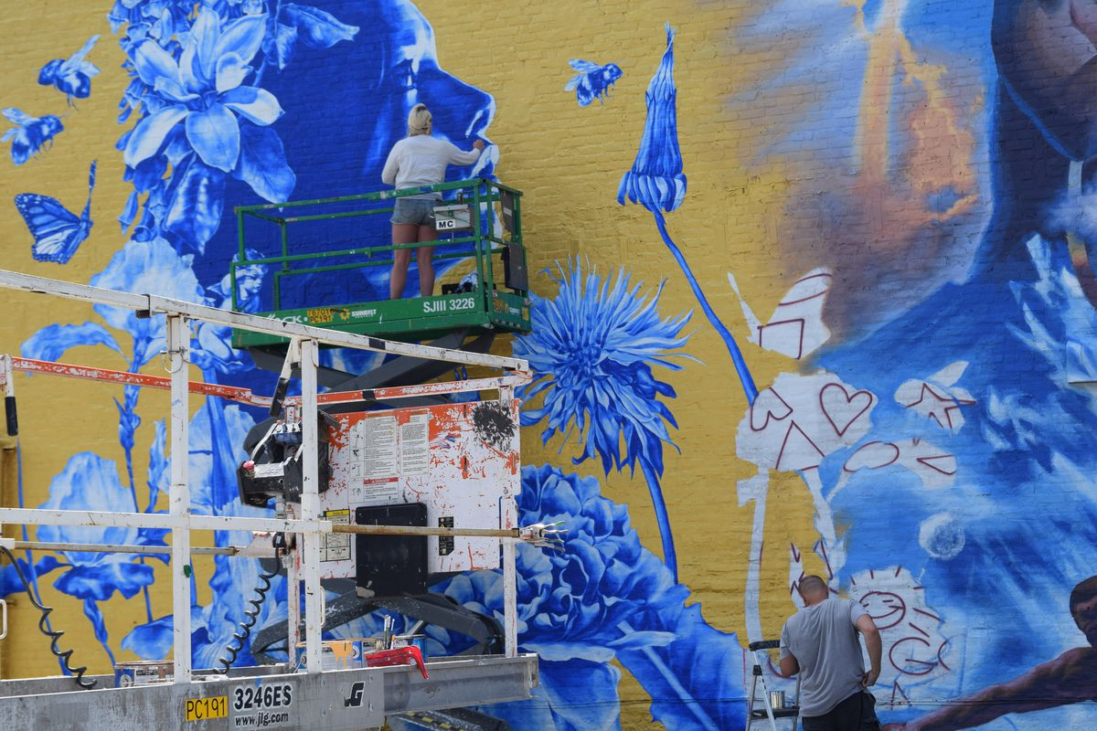 The flowers in Anna Murphy's part of the mural are foxgloves, common in her home country England.