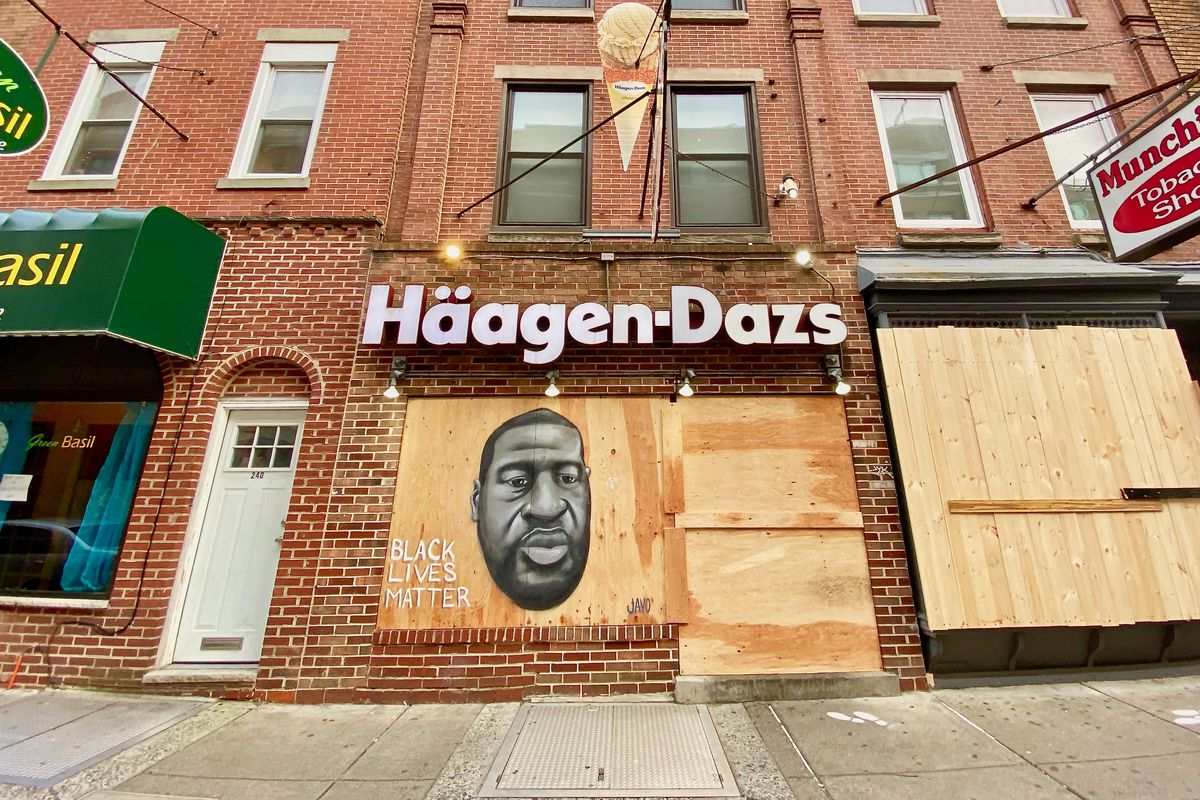 A drawing of George Floyd on the boarded-up front of a Haagen-Dazs ice cream shop on South Street in Philadelphia