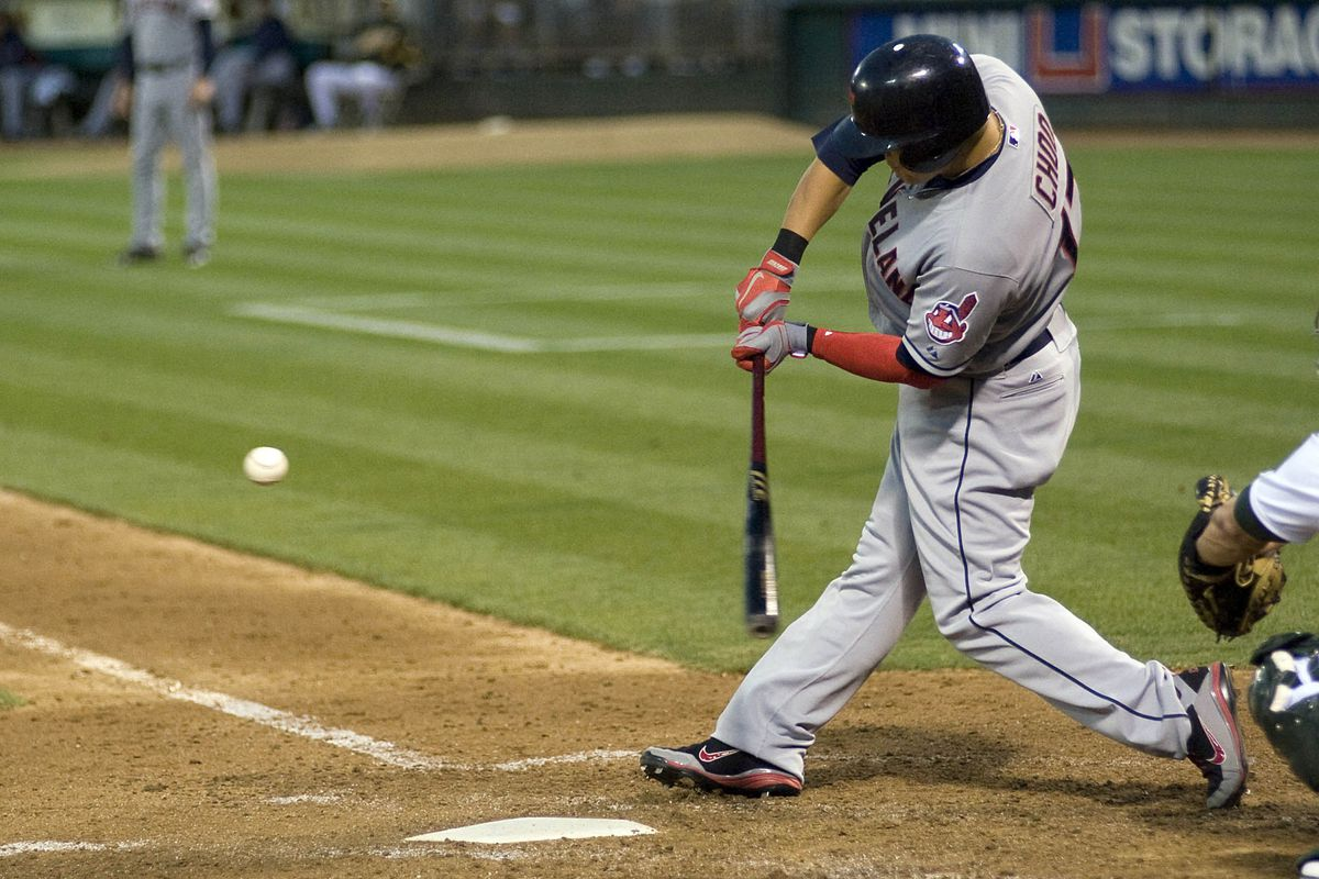 August 18, 2012; Oakland, CA, USA; Cleveland Indians right fielder Shin-Soo Choo (17) hits a home run during the ninth inning against the Oakland Athletics at O.co Coliseum.  Mandatory Credit: Ed Szczepanski-US PRESSWIRE