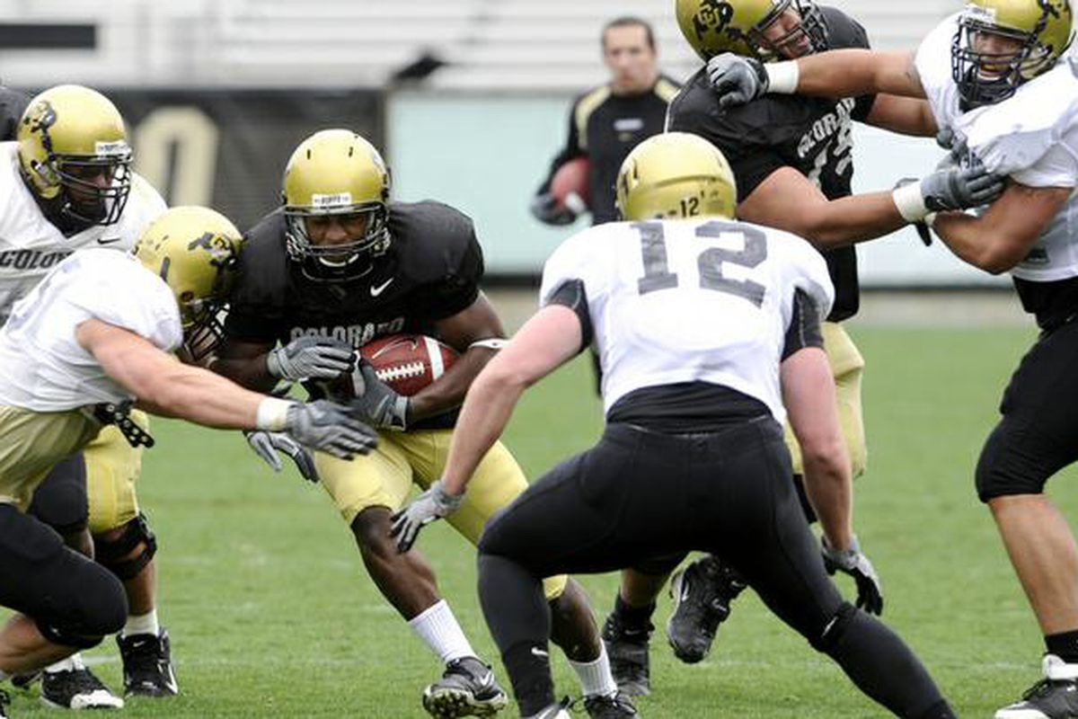 CU tailback Brian Lockridge, 20, attempts to drive through defensive back Patrick Mahnke, 12, during a scrimmage game at Folsom Stadium on the University of Colorado campus in Boulder, Colo. Saturday, April 11, 2009.