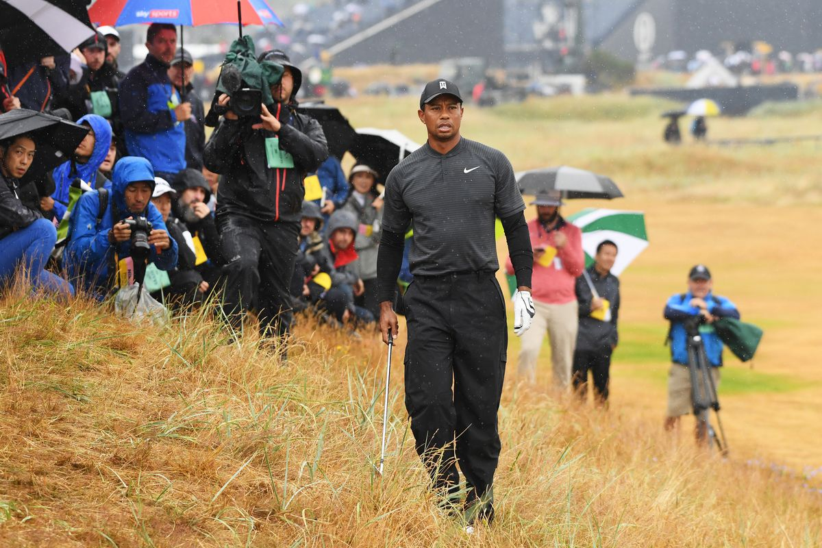 british open projected cut line  tiger woods safely on