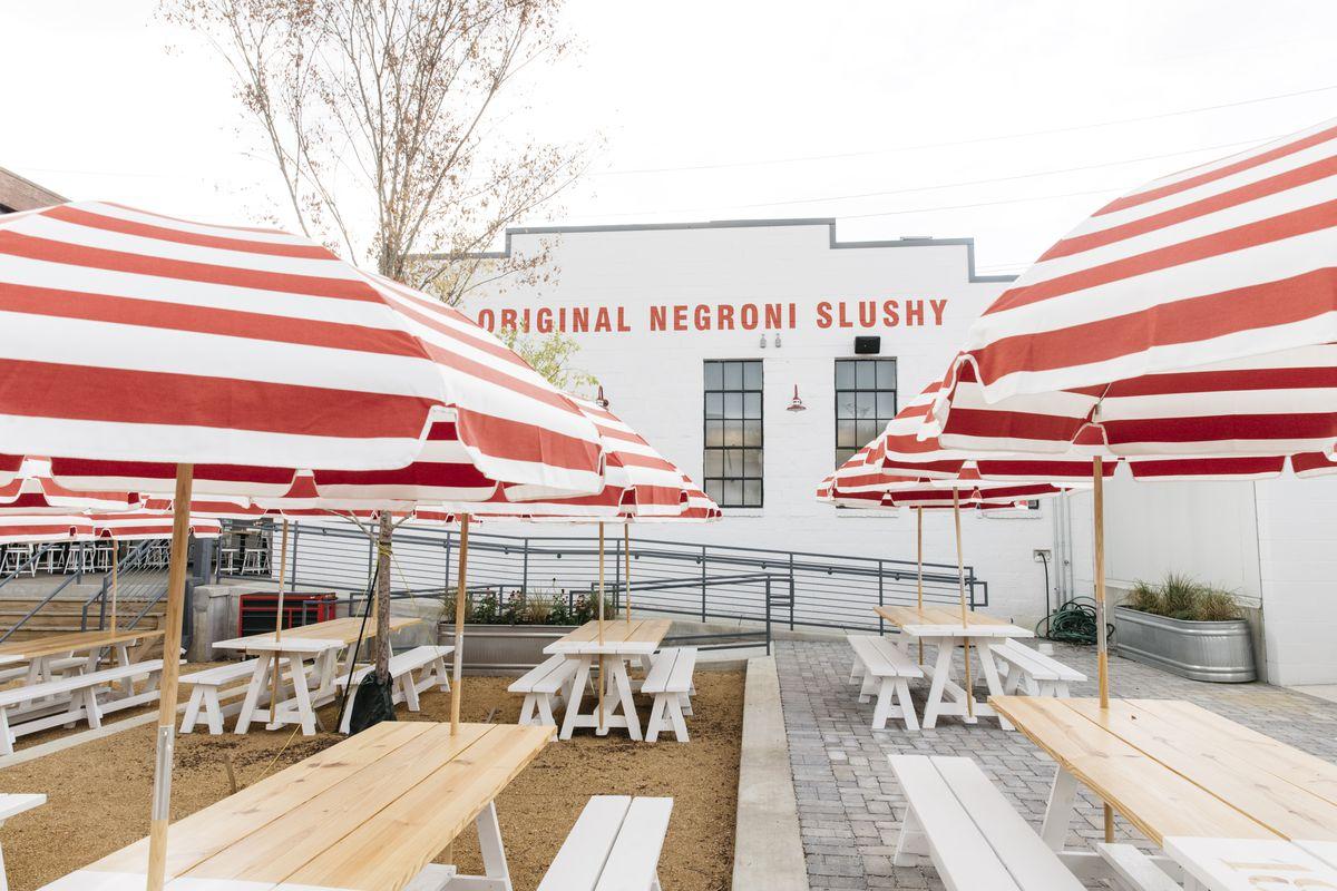Parson's Nashville picnic tables and umbrellas on the spacious patio